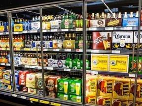 In this stock photo, a store's beer cooler is filled with beverages.