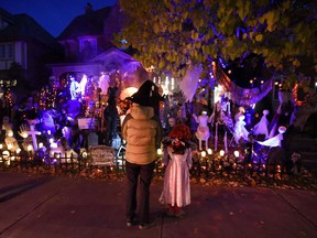 People go trick-or-treating at a decorated home in the Glebe neighbourhood in Ottawa on Halloween on October 31, 2016. THE CANADIAN PRESS/Justin Tang