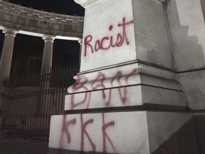 The statue of Confederate States of America President Jefferson Davis with the word 'racist' spray painted on it in Richmond, Va., on Oct. 17, 2017. (Graham Moomaw/Richmond Times-Dispatch via AP)