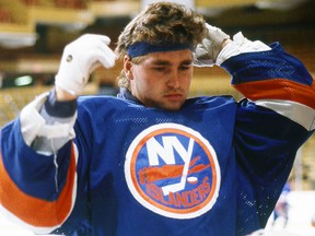 In this 1980 file photo, Kelly Hrudey of the New York Islanders adjusts his headband. (Steve Babineau/NHLI via Getty Images)