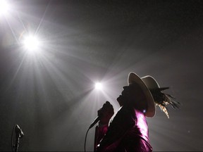 The Tragically Hip's Gord Downie, performs during the first stop of the Man Machine Poem Tour at the Save-On-Foods Memorial Centre in Victoria, B.C., Friday, July 22, 2016. Jim Cuddy shared the stage with fellow Canadian music star Gord Downie several times over their long careers, but it was a performance last February that was perhaps the most poignant. THE CANADIAN PRESS/Chad Hipolito ORG XMIT: CPT503