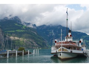 Beautifully restored century-old paddle steamers cross Switzerland's Lake Lucerne to connect with the mountain-climbing Gotthard Panorama Express.