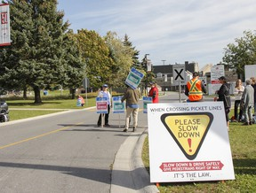 Local college faculty walk a picket line and speak with drivers entering all three entrances to St. Lawrence College Kingston campus on Thursday October 19, 2017 as the province-wide teachers strike enters its fourth day, with the no scheduled talks between Ontario Public Service Employees Union (OPSEU), representing faculty, and the College Employer Council.