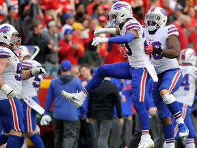 Buffalo Bills players, from left to right, Kyle Williams, Micah Hyde and Ryan Davis celebrate an interception against the Kansas City Chiefs on Nov. 26, 2017