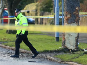 Police attend the scene where a stolen car crashed into a tree Saturday and killed several pedestrians in Leeds, England, Sunday Nov. 26, 2017.