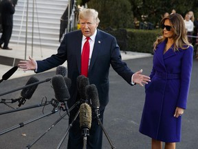 First lady Melania Trump looks on as President Donald Trump speaks with reporters before departing the White House for a trip to Asia, in Washington, on Friday, Nov. 3, 2017. (Evan Vucci/AP Photo)