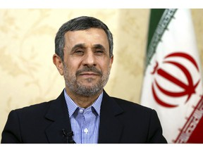 Former Iranian President Mahmoud Ahmadinejad gives an interview to The Associated Press at his office, in Tehran, Iran, Saturday, April 15, 2017.