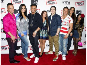 """Mike Sorrentino, Jenni Farley, Paul Delvecchio, Sammi Giancola, Vinny Guadagnino, Ronnie Ortiz-Magro, Deena Cortese, Nicole Polizzi  FILE - This Oct. 24, 2012, file photo shows """"Jersey Shore"""" cast members, from left, Mike """"The Situation"""" Sorrentino, Jenni """"JWoww"""" Farley, Paul """"Pauly D"""" Delvecchio, Deena Cortese, Vinny Guadagnino, Ronnie Ortiz-Magro, Sammi """"Sweetheart"""" Giancola and Nicole """"Snooki"""" Polizzi at a panel entitled """"Love, Loss, (Gym, Tan) and Laundry: A Farewell to the Jersey Shore"""" in New York. MTV announced that most of the original cast would return to the network for """"Jersey Shore Family Vacation,"""" a relaunch of the series set to debut in 2018. (Photo by Charles Sykes/Invision/AP, File) ORG XMIT: PAPM102  10241211517, 21334631, 32. OCT. 24, 2012 FILE PHOTO Charles Sykes, Charles Sykes/Invision/AP"""