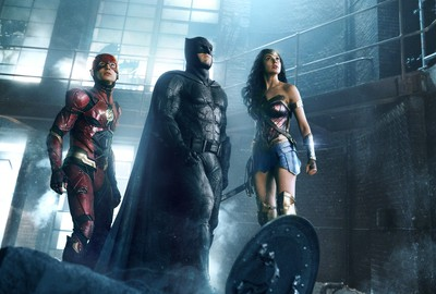 (L-r) EZRA MILLER as The Flash, BEN AFFLECK as Batman and GAL GADOT as Wonder Woman in Warner Bros. Pictures' action adventure