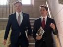 Finance Minister Bill Morneau and Prime Minister Justin Trudeau hold copies of the federal budget on their way to the House of Commons in Ottawa, Wednesday, March 22, 2017. THE CANADIAN PRESS/Adrian Wyld