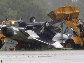 This June 23, 2017, file photo shows a military jet that ran off a runway and flipped over following a practice flight for the Dayton Air Show at Dayton International Airport.