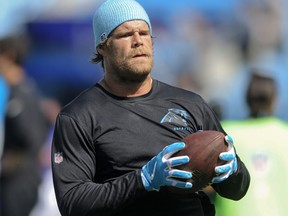 In this Sept. 17, 2017, file photo, Carolina Panthers tight end Greg Olsen warms up before the start of an NFL football game against the Buffalo Bills in Charlotte, N.C.