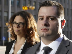 James Forcillo leaves 361 University Courthouse with his wife Irina Forcilla on Wednesday, Sept. 30, 2015.