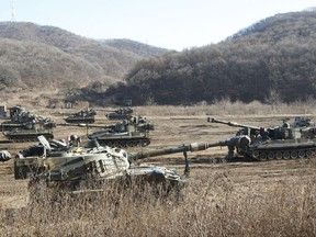 South Korean army's K-55 self-propelled howitzers take positions during a military exercises in Paju, South Korea, near the border with North Korea, Wednesday, Nov. 29, 2017. (AP Photo/Ahn Young-joon)