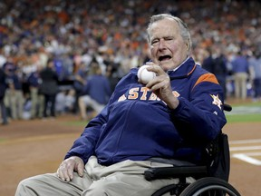 Former President George H.W. Bush waits on the field for first pitch ceremony before Game 5 of baseball's World Series against the Los Angeles Dodgers Sunday, Oct. 29, 2017, in Houston.