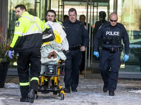 Paramedics with a person on a stretcher following a violent incident that left a baby in critical condition at a condo building at Sherway Gardens Rd. and Evans Ave. on Wednesday, December 13, 2017.