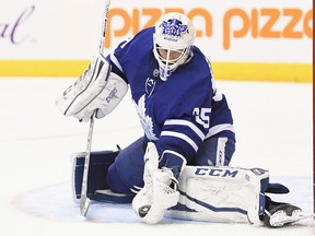 Toronto Maple Leafs goalie Curtis McElhinney (35) makes a save against the Edmonton Oilers during third period NHL hockey action in Toronto on Sunday, December 10, 2017. THE CANADIAN PRESS/Frank Gunn