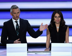 Presenter, Gary Lineker and Presenter, Maria Komandnaya speak to the audience during the Final Draw for the 2018 FIFA World Cup Russia at the State Kremlin Palace on December 1, 2017 in Moscow, Russia. (Photo by Matthias Hangst/Bongarts/Getty Images)