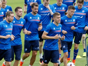 Players attend a training session of Iceland's national soccer team at their base camp in Annecy, France, on June 30, 2016