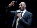 Former Los Angeles Lakers guard Kobe Bryant speaks during a halftime ceremony retiring both of his jersey numbers on Dec. 18, 2017