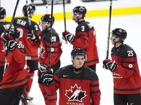 Team Canada players salute the crowd following their victory over Team Czech Republic on Dec. 21, 2017