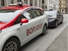 """A taxi with Bonjour on the side is seen Thursday, November 30, 2017 in Montreal. The National Assembly is formally asking Quebec's merchants to """"warmly"""" greet their clients with the word """"Bonjour,"""" and drop the old standard """"Bonjour-hi."""" THE CANADIAN PRESS/Ryan Remiorz ORG XMIT: RYR106"""