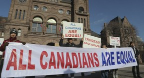 Demonstrators called for Prime Minister Justin Trudeau to apologize for his handling of the hijab hoax. (VERONICA HENRI, Toronto Sun)