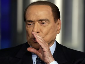 Italian former Prime Minister Silvio Berlusconi gestures during the recording of the Italian state television talk show in Rome, Thursday, Jan. 11, 2018.