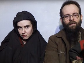 Screen capture on YouTube of Taliban video showing hostages Caitlan Coleman and Joshua Boyle in December 2016.