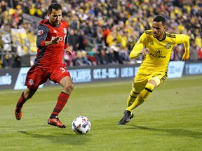 Steven Beitashour #33 of the Toronto FC and Artur #7 of the Columbus Crew SC chase after the ball during the second half at MAPFRE Stadium on November 21, 2017 in Columbus, Ohio. Columbus tied Toronto 0-0. (Photo by Kirk Irwin/Getty Images)