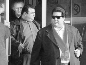 Pat Musitano (right), who was gunned down July 10, 2020, and his late brother Angelo (left) leave Hamilton court in January 1998.