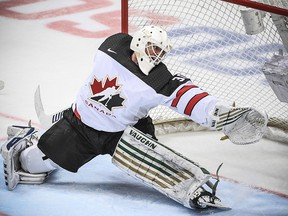 Canada's goaltender Ben Scrivens allows a goal during the Channel One Cup against Moscow on December 16, 2017.