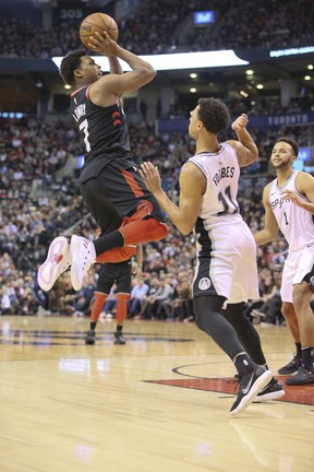 Toronto Raptors guard Kyle Lowry (7)and San Antonio Spurs guard Bryn Forbes (11) in Toronto, Ont. on Friday January 19, 2018.The Toronto Raptors host the San Antonio Spurs at the Air Canada Centre. Veronica Henri/Toronto Sun/Postmedia Network