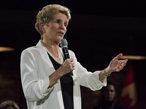 Premier Kathleen Wynne addresses questions from the public during a town hall meeting in Toronto on Monday, November 20, 2017.