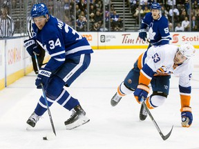 Toronto Maple Leafs' Auston Matthews takes the puck away from New York Islanders' Casey Cizikas during NHL action on Feb. 22, 2018