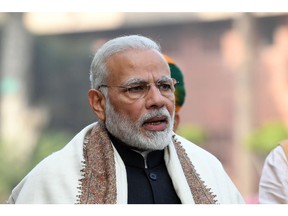 India Prime Minister Narendra Modi (C) addresses the media ahead of the dudget session at the Parliament house in New Delhi on January 29, 2018.