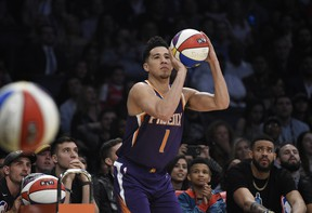 Phoenix Suns' Devin Booker shoots during the NBA basketball All-Star weekend 3-point contest on Saturday Booker won the event. (AP Photo/Chris Pizzello)
