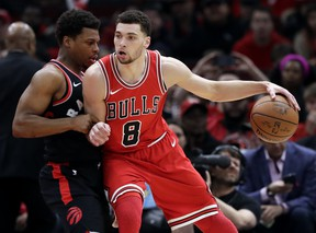 Chicago Bulls guard Zach LaVine, right, drives against Toronto Raptors guard Kyle Lowry during the first half of an NBA basketball game Wednesday, Feb. 14, 2018, in Chicago. The Associated Press