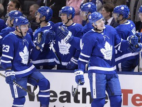 Toronto Maple Leafs defenceman Justin Holl (right) celebrates his first career goal in his first NHL game with teammate Travis Dermott (23) against the New York Islanders during third period NHL hockey action in Toronto on Jan. 31, 2018.  (FRANK GUNN/The Canadian Press)