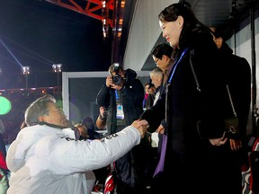 North Korean Leader Kim Jong Un's sister Kim Yo Jong (R) shakes hands with South Korean President Moon Jae-in (C) during the opening ceremony of the Pyeongchang 2018 Winter Olympic Games in Pyeongchang on Feb. 9, 2018. (AFP/Getty Images)