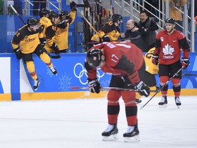 German players celebrate their Olympic men's hockey semifinal win over Canada on Feb. 23.