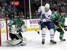 Dallas Stars goaltender Ben Bishop (30) defends as Toronto Maple Leafs left wing James van Riemsdyk (25) deflects a puck toward Bishop as defenseman Esa Lindell (23) of Finland watches in the second period of an NHL hockey game Thursday, Jan. 25, 2018, in Dallas. van Riemsdkyk did not score on the play.