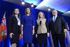Ontario PC leadership candidates Tanya Granic Allen, Caroline Mulroney, Christine Elliott and Doug Ford pose for a photo after participating in a debate in Ottawa on Wednesday, Feb. 28, 2018. (THE CANADIAN PRESS/PHOTO)