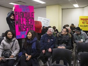 Rent strikers from a rental building at 1251 King Street West and fellow protesters gather in a Social Justices Tribunal Ontario hearing room, in Toronto on Friday, February 2, 2018.