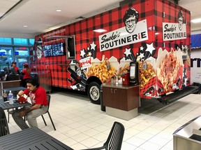 The famous Smoke's Poutinerie food truck greets passengers at Toronto Pearson International Airport's Terminal 3 arrivals department
