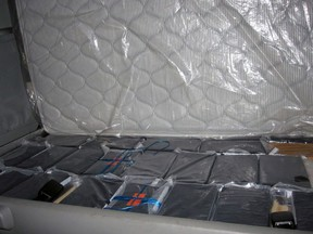 Bricks of cocaine that were found among the nearly 100 kgs of cocaine seized on December 2, 2017. Agents at Coutts  border crossing found 84 bricks containing nearly 100 kgs of cocaine in the cab of a commercial vehicle. The commercial vehicle was hauling produce from California to an Alberta business. SUPPLIED PHOTO