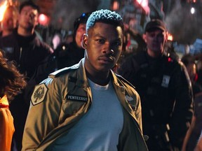 "This image released by Universal Pictures shows, foreground from left, Cailee Spaeny, John Boyega and Scott Eastwood in a scene from ""Pacific Rim Uprising."" (Legendary Pictures/Universal Pictures via AP) ORG XMIT: NYET601"