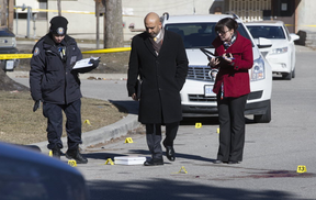 A day after Nnamdi Ogba was gunned down on Scarlettwood Ct., in Etobicoke, Toronto Police investigate the deadly shooting on Saturday, March 17, 2018.