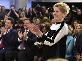 Ontario Premier Kathleen Wynne applauds staff and patients during a CAMH mental health funding announcement in Toronto on Wednesday March 21, 2018.