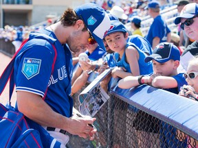 Toronto Blue Jays fielder Randal Grichuk signs autographs for fans prior to a spring training game in Dunedin on Feb. 25, 2018